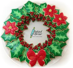Christmas holly leaf decorated sugar cookies. Royal icing. Green, red, yellow, white. Marbled. Wreath, poinsettia, bow.