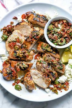 A simple marinade with two kinds of balsamic vinegar, fresh herbs, and grainy mustard gives this grilled balsamic chicken topped with an easy olive and sun dried tomato tapenade a classic Mediterranean flavor zing. Healthy Meals For Two, Easy Healthy Dinners, Healthy Dinner Recipes, Delicious Recipes, Tasty, Grilling Recipes, Cooking Recipes, Kitchen Recipes, Balsamic Chicken