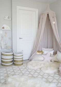 Neutral white and tan get a girly boost from blush or ash rose accessories. To keep the room from looking too bland, combine a variety of textures, from jute baskets to super soft furry rugs.