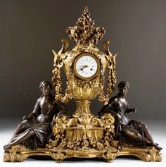 Raingo Freres French figural mantle clock.worthpoint.com
