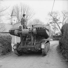 Valentine bridgelayer passing through a village during Exercise 'Spartan', 6 March 1943.