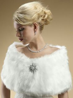 A gorgeous and luxurious wholesale 1920s inspired Faux Fur Bridal Wrap in Pure White fox that will add glamour to your entire outfit.