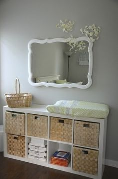 Ok, so yes this is in a baby's room... but I really love the look of those straw baskets & white shelves! Cute alternative to a dresser perhaps. by roberta