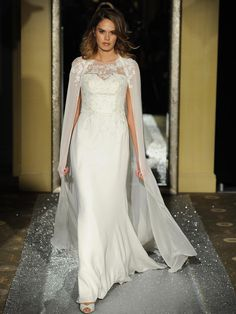 Oleg Cassini fit and flare wedding dress with cape