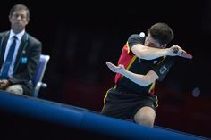 Germany's Dimitrij Ovtcharov serves to Hong Kong's Tang Peng during the men's team bronze medal match
