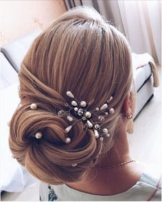 Check out these beautiful updo wedding hairstyle inspiration,elegant hairstyle inspiration,wedding hairstyle for long hair,wedding hair ideas