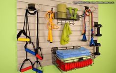 Tip of the Day: use a hanging storage wall to organize everything you need for an in-home workout. If you leave it out in the open instead of hiding it in a closet you'll be more likely to use it!