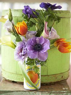 BHG has more than 20 ideas. Here: A Frugal Wedding Vase AlternativeA Frugal Wedding Vase Alternative Get creative with alternatives for vases. Here, we used a charming fruit-juice can. Cup off the top and fill with something heavy, such as small marbles or pebbles. Fill with water and place flowers, such as anemones, tulips, calla lilies, and lisianthus as pictured.