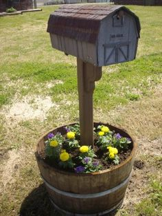 mailbox planter after he finished, the mailbox is the old mailbox we had growing up, i always loved that mailbox! lol i stuffed my cat in there a few times! lol thanx for saving it mom!