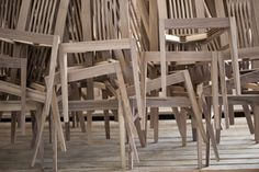 stacks of unfinished wood chairs