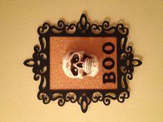 Halloween diy craft: wood frame, black acrylic paint, sparkly craft paper, cardboard, wood letters, styrofoam skeleton head, cardboard, tacky glue, and hot glue.