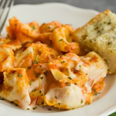 An easy recipe for Cheesy Baked Tortellini, made with a combination of traditional spaghetti sauce and béchamel sauce. Baked Tortellini Recipes, Tortellini Bake, Pasta Recipes, Chicken Tortellini, Entree Recipes, Meat Recipes, Cooking Recipes, Yummy Recipes, Yummy Food