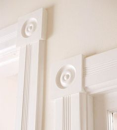 Add Drama to Doors  Want something more inspiring than standard 1x4 trim? Try decorative, patterned molding with mismatching head (top) and corner blocks. Even a subtle pattern is a step up.