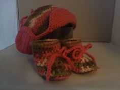crocheted baby's hunters cap and matching booties