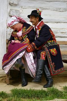 An older Polish couple wearing folk clothing from Nowy Sącz region in Poland showing that they're young at heart ;)