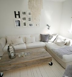 Nostalgic white home rich with handmade pieces of furniture and decorations