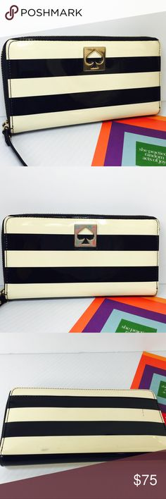 NWOT Kate Spade Large Wallet Fantastic Kate Spade wallet, never used or carried. Larger size to hold all your essentials. I have a similar one and I tuck my iPhone inside it.  Has 16 cc slots 3 interior pockets and 1 middle zippered coin pocket. Black and off white striped. All leather. Has 2 very small pen marks on back side as shown in 3rd pic. Hardly noticeable and priced accordingly. kate spade Bags Wallets