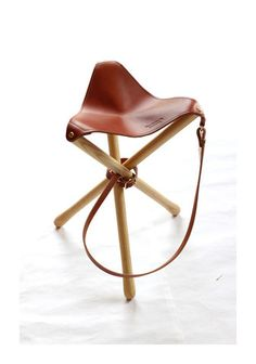 Tripod Camp Stool: A staple in every camp kit. Constructed of ash hardwood and English bridle leather, made in the USA by the talented folks at Wood & Faulk, this camp stool is destined to become a modern classic Made in USA