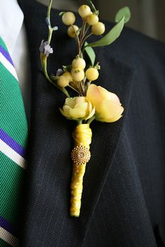 this boutonniere is way too big, but i love the color of the ranunculus