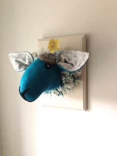 Whimsical spring sheep trophy. Yellow flower. Turquoise lamb head. £100.00