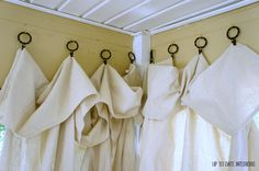 Great idea for hanging diy porch curtains from Up to Date Interiors!