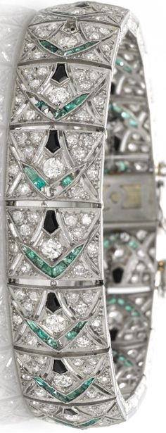 An art deco diamond, emerald and black onyx bracelet,