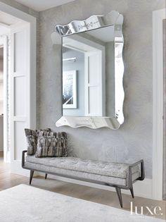 Great entry idea. Mirror. Bench. Gray. Silver. Metal.
