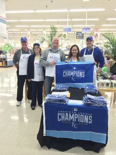 Volunteers sold limited edition 2014 American League Champions flags at area Hy-Vee Stores for Greater Kansas City Day on April 6th.