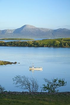 Co Mayo, Ireland Fishing Boat In Clew Bay Beneath Croagh Patrick