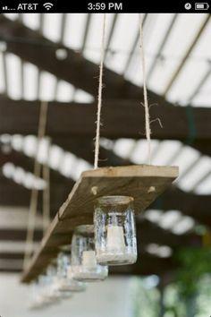 Wood plank, mason jars, jute twine, candles.....amazing outdoor picnic table chandelier!