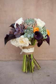 Modern wedding bouquet idea - succulent bouquet with white + purple flowers {Laura Segall Photography}