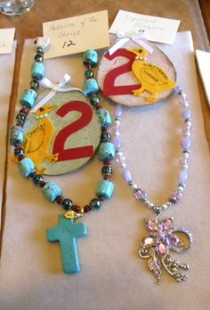 I made the necklace with the blue cross. My friend Nancy made the purple one. Let me know what you think.