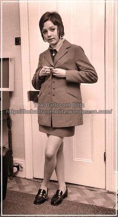 """Young skinhead girl wearing a suit with """"twin jet pockets"""" I had to look in the dictionary for this one, in Spanish is """"bolsillos de ojal"""", ..."""