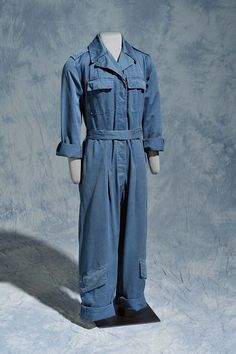 #TextileTuesday! Kate Lee Adams of Durham wore these blue cotton twill flight coveralls as a Woman Airforce Service Pilot (WASP) during #WWII. A group of civilian volunteers trained by the Army, the WASPs flew military planes in non-combat situations to free up male pilots for battle missions. Because the women were issued used men's airplane mechanics' coveralls, most had to roll up the sleeves and cuffs as shown here.