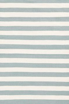 This website has the best nautical striped rugs. SO PRETTY.