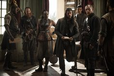 Black Sails - Madi and captain James Flint with John Silver