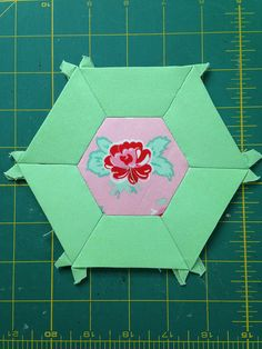 Smitten Quilt Small Hexagon Two D   Join our English Paper Piecing Group on Facebook.  https://www.facebook.com/groups/smittenquilt/