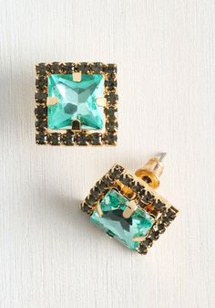 In a rush? There's always enough time to shine with these aqua blue earrings on hand. Trimmed in gold metal, dotted with smoky grey rhinestones, these studs are sure to dazzle in a dash!