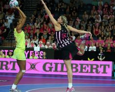 Ferns Casey Williams and Australia's Carla Dziwoki in action during the final match between New Zealand and Australia netball match at the Netball World Series in Auckland. Michael Bradley, Silver Fern, Netball, World Series, New Zealand, Finals, Basketball Court, Australia, News