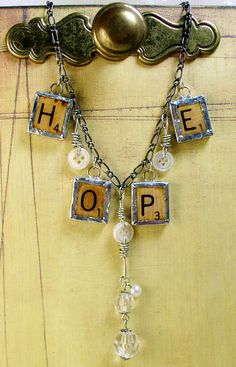 """Includes four hand soldered and resined pendants to spell out the """"HOPE"""". Letters are scabble tiles that measure 3/4"""" x 3/4"""". Buttons are hand wrapped for a little extra vintage chunky flair. Includes 18"""" Chain."""