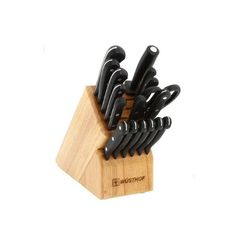Wusthof Gourmet 18 Piece Knife Block Set. High carbon stainless steel blades with black plastic handles; wooden knife block. Set includes one peeling knife, one trimming knife, two paring knives, six steak knives, two utility knives, one kitchen knife, one bread knife, one chef's knife, one honing steel, one pair of kitchen shears, and one 17 slot knife block. Triple riveted handle. Ergonomic handles provide comfortable grip. Wood knife block handsomely and safely stores all pieces of the…