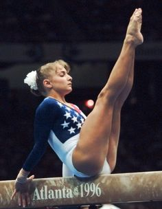 Shannon Miller was the team's highest scorer, individually placing second overall after the team competition. While mistakes put the individual All-Around title out of reach, Miller rebounded for a gold medal in the balance beam, making her the first American to win the balance beam at the Olympics and the first to win an individual gold medal at a non-boycotted Olympics. (AP Photo/John Gaps III)