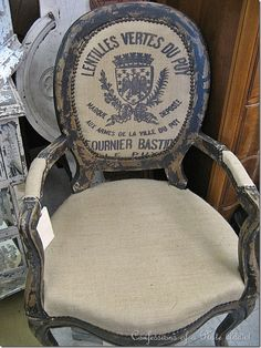 french grain-sack upholstered chair at 'queen of hearts' antiques • georgia ❀ ~  ◊  photo via 'confessions of a plate addict' blogspot