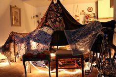Forts!  I may just have to try this over spring break!  Never thought to use the light fixture for height!