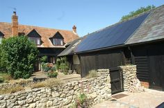 Solarworld in built roof solar panels installed by Ecohouse in Chearsley near Aylesbury.