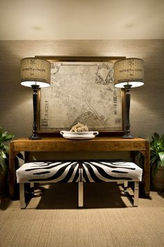 Beautiful Console table, love the zebra ottoman, the map art work & lamps. Great mix of Textures