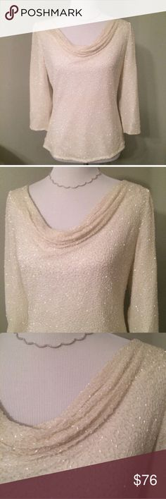 Laurence Kazar Vintage Silk Beaded Top This ivory vintage top is in immaculate condition. Stunning beading with loose neckline. It looks brand new and sparkles so beautifully. 💯% silk shell, top quality. These are out of production & you won't find another one like it! Especially in this condition. By designer Laurence Kazaar. Laurence Kazar Tops Blouses