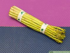 4 Ways to Steam Asparagus - wikiHow How To Cook Asparagus, Steamed Asparagus, Fresh Asparagus, Vegetable Drinks, Vegetable Dishes, Healthy Eating Tips, Healthy Nutrition, Asparagus On The Stove
