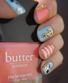 Beautiful nautical nails with pretty blue, coral, stripes, glitter and gems. Love it! #nailart #naildesign #nautical