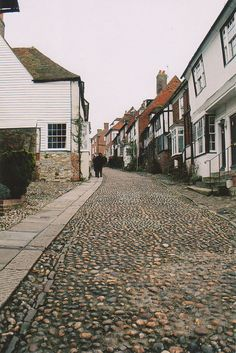 Oh MERMAID STREET!! I know for certain by the House With Two Doors (white house first on your right) The houses on Mermaid all have names, like The House Opposite and First House and Jeake's House and are mostly fifteenth and sixteenth century. This is in Rye, East Sussex, on the southern coast of England.